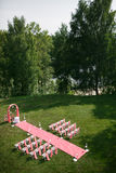 Wedding registration beautiful in nature. White chairs for visiting registration. Pink tent with white flowers for the Stock Photo