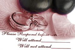 Wedding Reservation. Wedding rings on top of a wedding reservation Stock Photos