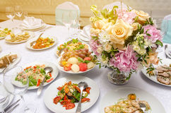 Wedding restaurant and decorated banquet table. Banquet table in a restaurant with flowers. Wedding decorated Royalty Free Stock Photography