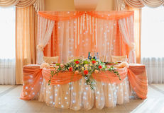 Wedding restaurant table. Decorated in peach colour Stock Images