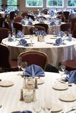 Wedding or restaurant tables. Tables set for fine dining at a wedding or event. This image has a shallow depth of field, with the focus on the center table stock photography