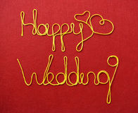 Wedding ribbon greeting and hearts on red background Stock Photo