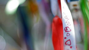 Wedding ribbons hanging and fluttering in the wind.  stock footage