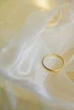Wedding ring. On white silk stock image