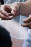 Wedding Ring. Bride about to put ring on groom Stock Image