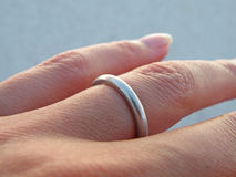 Wedding Ring. Detail of a silver wedding ring on woman's hand Royalty Free Stock Images