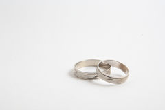 Wedding ring. White gold wedding rings on white background, this composition is used for invitation cards Royalty Free Stock Images