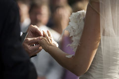 Wedding Ring. View of the the moment when the wedding ring is placed at the finger of the bride Royalty Free Stock Images