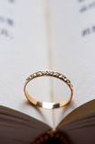 Wedding ring. A wedding ring in a book Stock Image