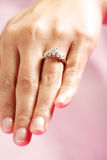 Wedding ring. A woman hand wearing a diamond ring Royalty Free Stock Photography