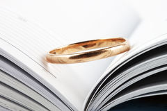 Wedding ring. Putted on the opened book Stock Photos