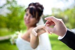 Wedding ring. On bride's finger Stock Image
