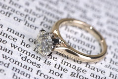 Wedding ring. A very large diamond ring on a bible Stock Photos