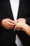 Wedding ring. A groom putting a wedding ring on the bride Royalty Free Stock Photos