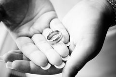 Wedding ring. Laying in the hands of the bride Stock Photos
