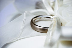 Wedding ring. Made of white gold on the pillow with a bow Royalty Free Stock Images