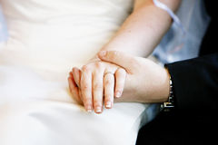 Wedding Ring. A groom holding a bride's hand showing their wedding ring Stock Images