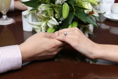 Wedding ring. A Young couple holding hands Royalty Free Stock Photo