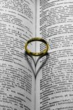 Wedding ring. A wedding ring on a book Stock Photography