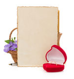 Wedding ring and aged paper Stock Photos
