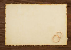 Wedding ring and aged paper Stock Photography
