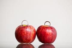 Wedding ring on apple Stock Photos