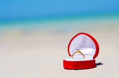Wedding ring on the beach Stock Image