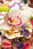 Wedding ring and beautiful flowers. Royalty Free Stock Photography