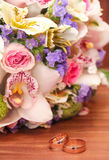 Wedding ring and beautiful flowers. Royalty Free Stock Image