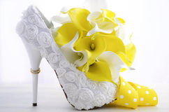 Wedding ring on beautiful white stiletto shoe heel. Stock Photos