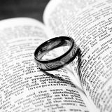 Wedding ring and bible Royalty Free Stock Photography