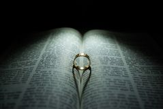 Wedding Ring and Bible Stock Photos