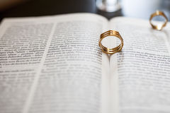 Wedding ring. And the bible Stock Photos