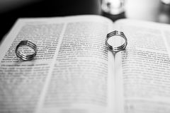 Wedding ring. And the bible Stock Image