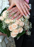 Wedding ring with bouquet Stock Photography