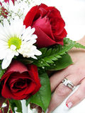 Wedding ring and bouquet closup. Bride's bouquet closeup and wedding ring Royalty Free Stock Images