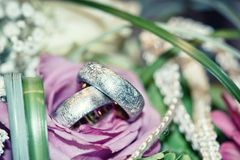 Wedding ring. In a bouquet of flowers Stock Images