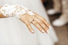 Wedding ring on bridal hand. With ladybug royalty free stock image