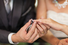 The Wedding Ring on bride. Close up Groom Put the Wedding Ring on bride Stock Photography