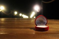 Wedding Ring on the Bridge on wedding day. preparation for betrothal. Wedding ring for bride and groom on wedding day. Ring on the space window royalty free stock photo