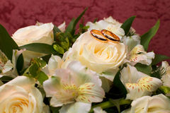 Wedding ring on the bride's bouquet. Stock Photos