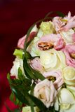 Wedding ring on the bride's bouquet. Stock Photography