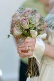 Wedding ring on bride's finger Royalty Free Stock Image