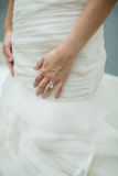 Wedding ring on bride's finger. Wedding ring on a bride's finger royalty free stock images
