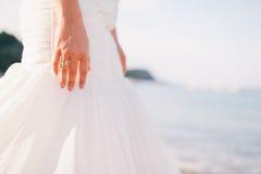Wedding ring on bride`s hand Stock Image