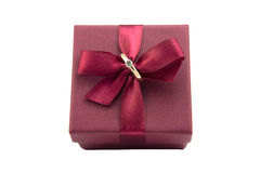 Wedding ring in burgundy box with bow isolated on white background Stock Photos