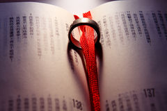 Wedding Ring on a chinese bible.  Stock Photography