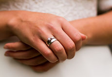 Wedding ring. Close-up of brides hands, displaying the wedding ring next to the engagement ring (both worn on the brides right ring finger stock image