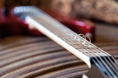 Wedding ring close-up  on electric  guitar strings Stock Photography