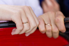 Wedding ring on couples hand Royalty Free Stock Images